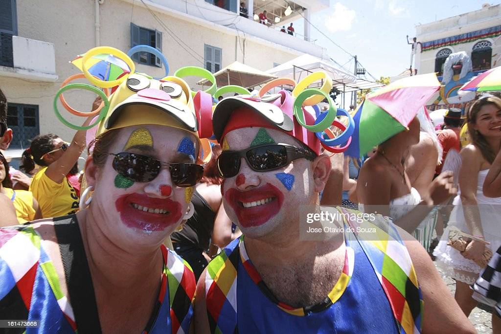 Revelers enjoy the parade followed by thousands of people during the Carnival on February 11, 2013 in Olinda, Brazil