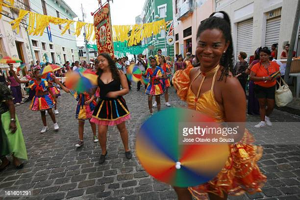 Revelers enjoy the parade followed by thousands of people during the Carnival on February 12 2013 in Olinda Brazil
