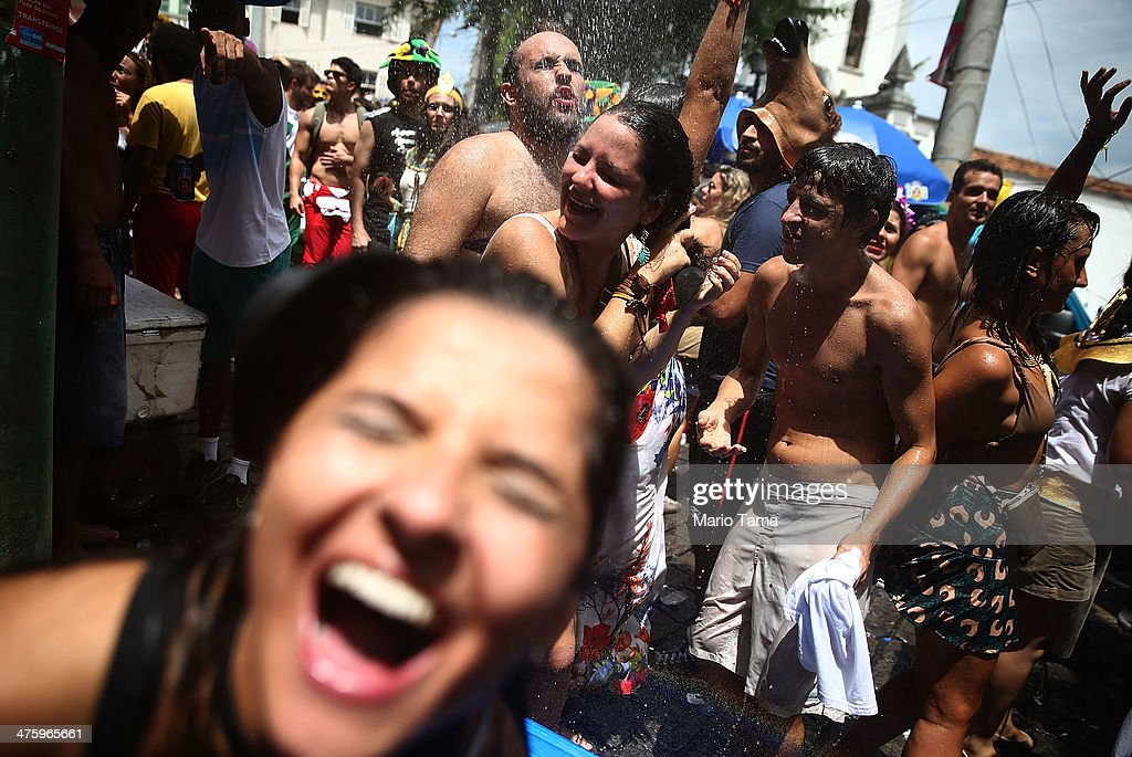 Revelers exalt during the 'Ceu na Terra' street carnival bloco on March 1, 2014 in Rio de Janeiro, Brazil. Carnival is the grandest holiday in Brazil, annually drawing millions in raucous celebrations.