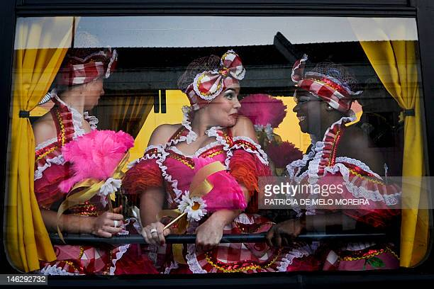 Revelers from a typical Lisbon neighborhood Alfama sit in a bus that will take them to the Saint Anthony's Parade on Avenida da Liberdade in Lisbon...