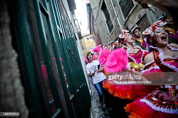 Revelers from a typical Lisbon neighborhood Alfamawalk down a street on theior way to the Saint Anthony's Parade on Avenida da Liberdade in Lisbon on...