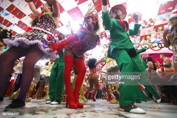 Revelers from the Grande Rio samba school dance during a traditional Festas Juninas party at the Salgueiro samba school on June 18 2017 in Rio de...