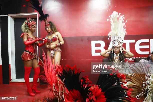 Revelers from the Grande Rio samba school prepare to perform during a traditional Festas Juninas party at the Salgueiro samba school on June 18 2017...