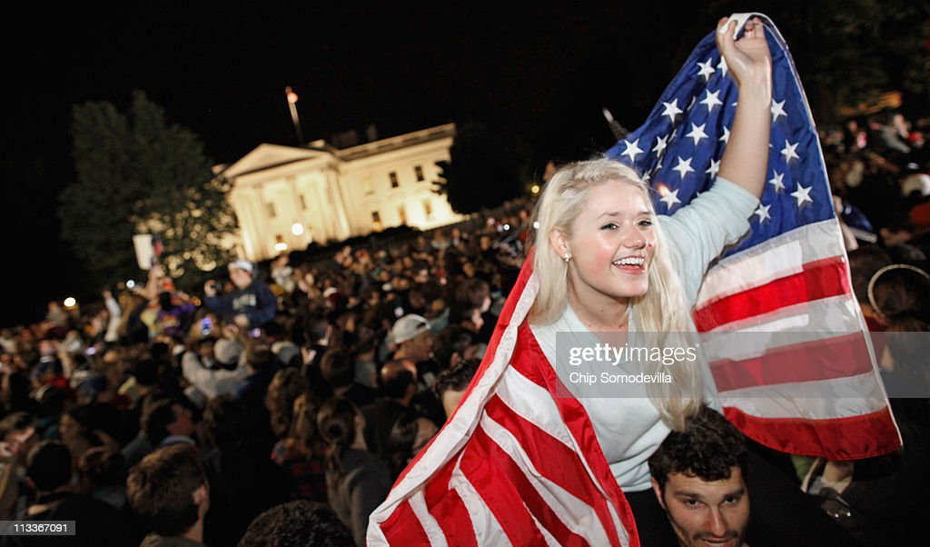 Revelers gather at the fence on the north side of the White House, pose for photographs, chant 'U.S.A.! U.S.A.!' and sing the Star Spangled Banner while U.S. President Barack Obama announces the death of Osama Bin Laden during a late evening statement to the press in the East Room of the White House May 1, 2011 in Washington, DC. Bin Laden has been killed near Islamabad, Pakistan almost a decade after the terrorist attacks of Sept. 11, 2001 and his body is in possession of the United States.