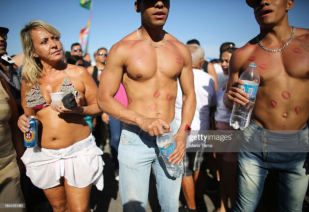 Revelers gather during Rio de Janeiro's 18th Gay Pride Parade along Copacabana Beach on October 13, 2013 in Rio de Janeiro, Brazil. Brazil is the world's largest Catholic nation with an estimated 60,000 gay couples. In May, Brazil became the third country in Latin America to effectively approve same-sex marriage via a court ruling, but a final law has yet to be passed.