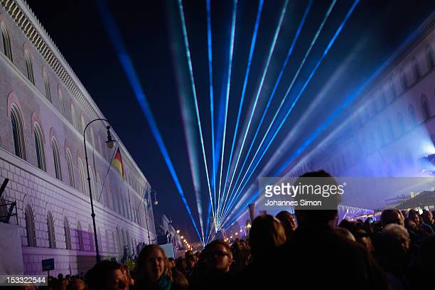 Revelers gather in the city center to watch the final laser show of German Unity Day on October 3 2012 in Munich Germany The event marks the day in...