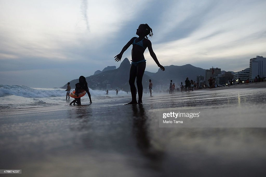 Revelers gather on Ipanema Beach during the Banda de Ipanema street carnival bloco on March 4, 2014 in Rio de Janeiro, Brazil. Carnival is the grandest holiday in Brazil, annually drawing millions in raucous celebrations.