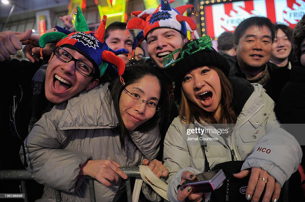 Revelers gather together as thousands gather in New York's Times Square to celebrate the ball drop at the annual New Years Eve celebration on December 31, 2011 in New York City.
