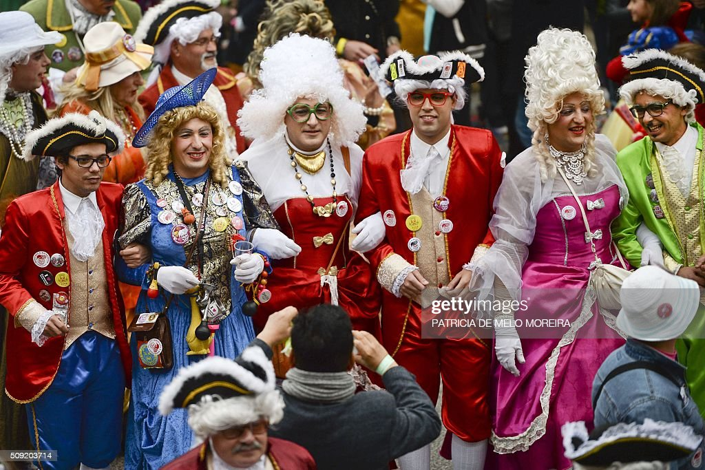 Revelers in fancy dress participate in the annual carnival parade in Torres Vedras on February 9, 2016. The Torres Vedras Carnival is allegedly the 'most Portuguese' of all the carnivals in the country recognized by the strong political and football satire of the revelers disguises and their floats. / AFP / PATRICIA DE MELO MOREIRA
