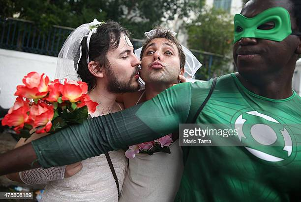Revelers kiss while posing during the 'Ceu na Terra' street carnival bloco on March 1 2014 in Rio de Janeiro Brazil Carnival is the grandest holiday...