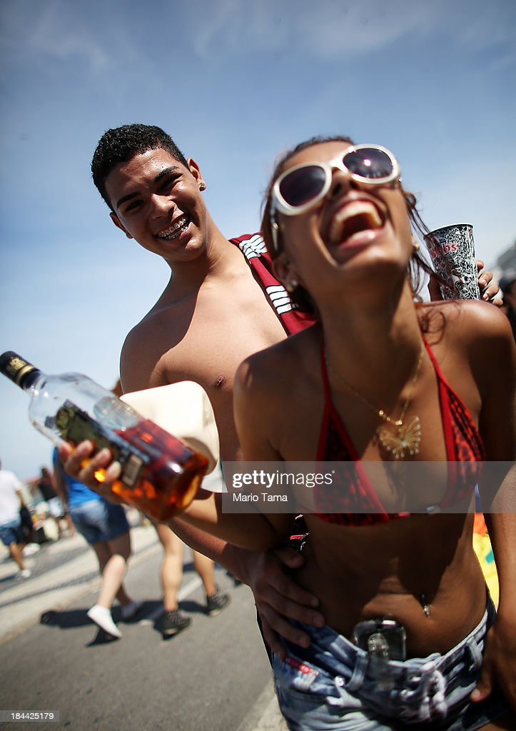 Revelers laugh during Rio de Janeiro's 18th Gay Pride Parade along Copacabana Beach on October 13, 2013 in Rio de Janeiro, Brazil. Brazil is the world's largest Catholic nation with an estimated 60,000 gay couples. In May, Brazil became the third country in Latin America to effectively approve same-sex marriage via a court ruling, but a final law has yet to be passed.