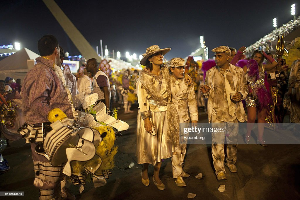 Revelers leave the Sambadrome after finishing their parade during Carnival celebrations in Rio de Janeiro, Brazil, on Monday, Feb. 11, 2013. The festivities, which are expected to attract almost 900,000 visitors, precede the start of Lent, which begins with Ash Wednesday on Feb. 13. Photographer: Dado Galdieri/Bloomberg via Getty Images