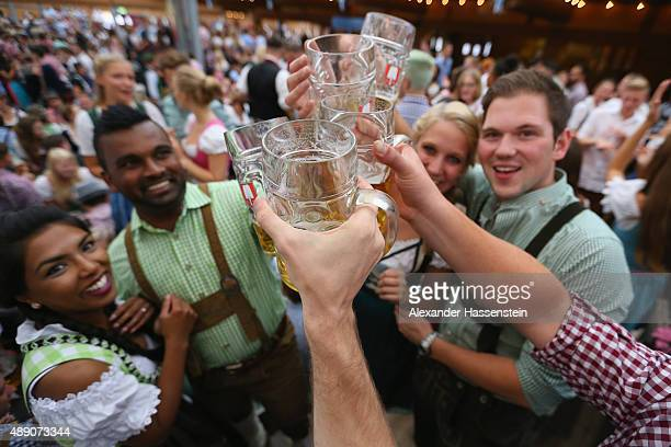 Revelers long for the first tapped beer mug at the Schottenhamel beer tent on the opening day of the 2015 Oktoberfest on September 19 2015 in Munich...