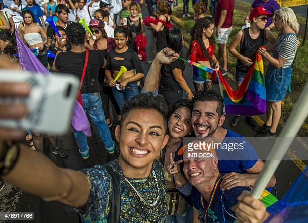 Revelers make a selfie during the Gay Pride Parade in Managua on June 28 2015 AFP PHOTO / Inti OCON