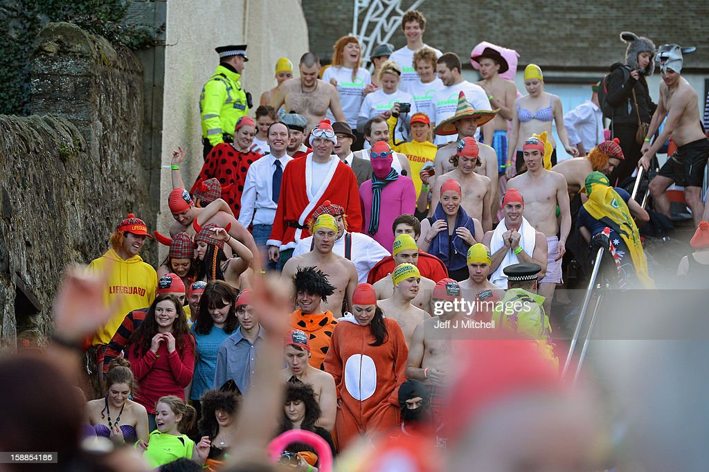 Revelers make their way down steps as they joined around 1,000 New Year swimmers, many in costume, braved freezing conditions in the River Forth in front of the Forth Rail Bridge during the annual Loony Dook Swim on January 1, 2013 in South Queensferry, Scotland. Thousands of people gathered last night to see in the New Year at Hogmanay celebrations in towns and cities across Scotland..