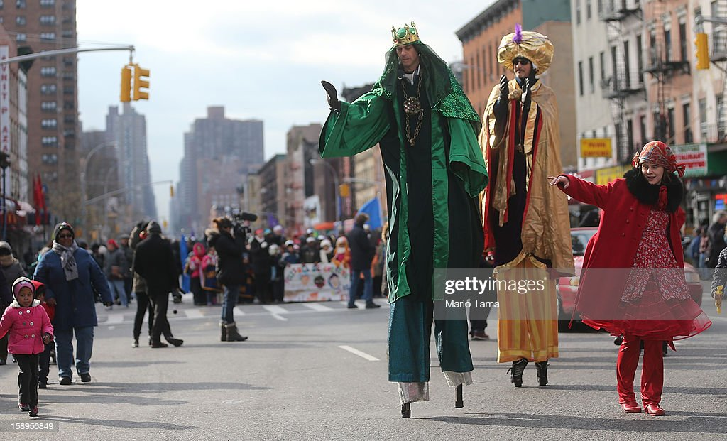 Revelers march during the Three Kings Day Parade in East Harlem on January 4, 2013 in New York City. The parade celebrates the Feast of the Epiphany, also known as Three Kings Day, marking the Biblical story of the visit of three kings to Bethlehem to visit the baby Jesus, revealing his divinity.