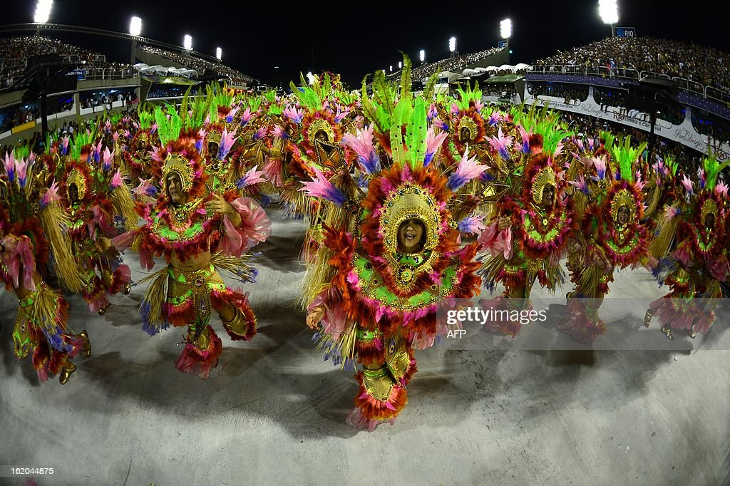 Revelers of Mangueira samba school perform atop a float during the second night of Carnival parades at the Sambadrome in Rio de Janeiro on February 11, 2013.