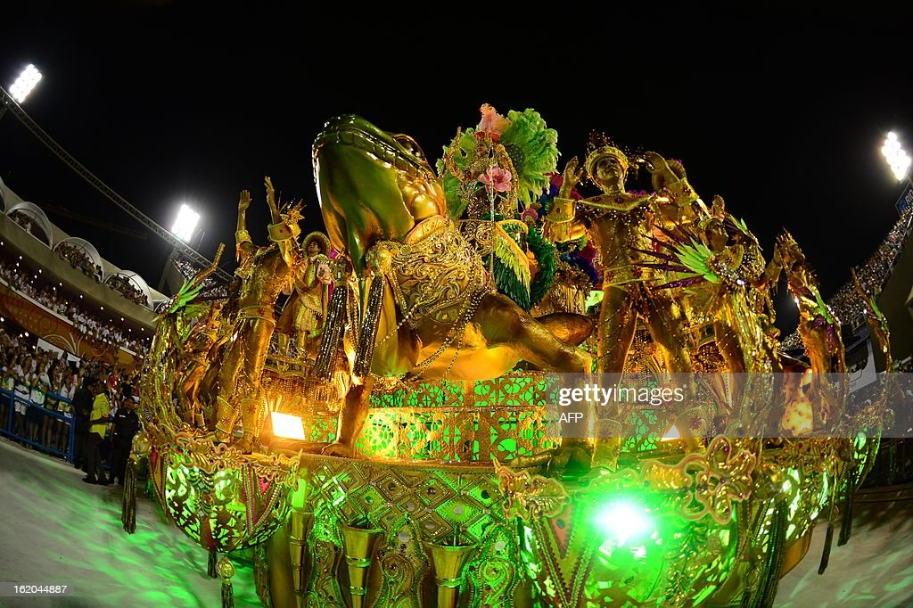 Revelers of Mangueira samba school perform atop a float during the second night of Carnival parades at the Sambadrome in Rio de Janeiro on February 11, 2013. AFP PHOTO / CHRISTOPHE SIMON