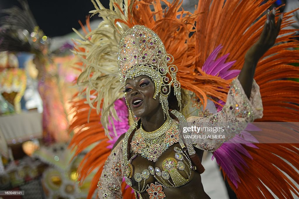 Revelers of Mangueira samba school perform during the second night of Carnival parades at the Sambadrome in Rio de Janeiro on February 11, 2013. AFP PHOTO / VANDERLEI ALMEIDA