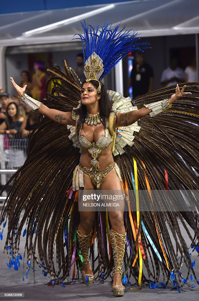 Revelers of the Academicos do Tucuruvi samba school perform during the second night of the carnival parade at the Sambadrome in Sao Paulo, Brazil, on February 6 2016. AFP PHOTO / NELSON ALMEIDA / AFP / NELSON ALMEIDA
