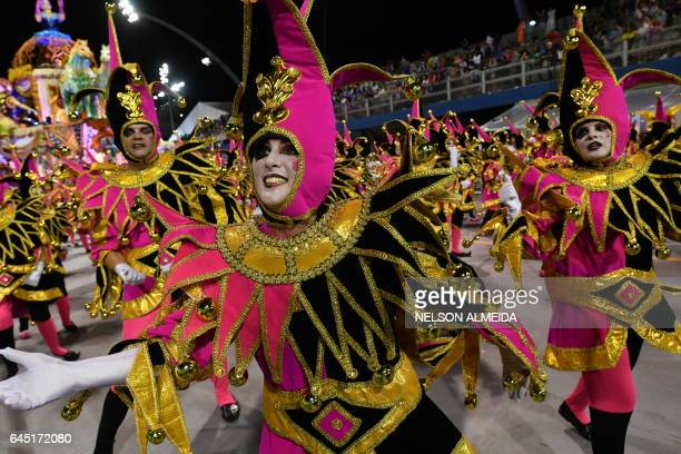 TOPSHOT Revelers of the Academicos do Tucuruvi samba school perform during the first night of carnival parade at the Sambadrome in Sao Paulo Brazil...
