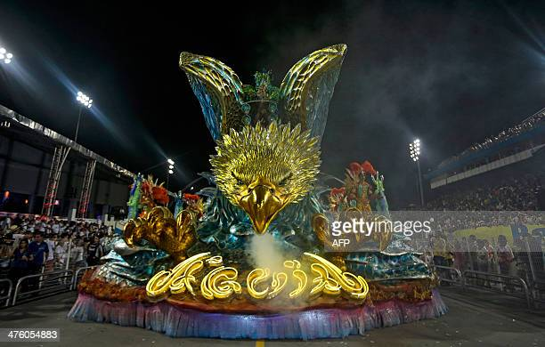Revelers of the Aguia de Ouro samba school perform atop a float during the second night of carnival parade at the Sambadrome in Sao Paulo Brazil on...