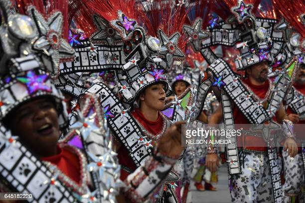 Revelers of the Aguia de Ouro samba school perform during the first night of carnival parade at the Sambadrome in Sao Paulo Brazil early on February...