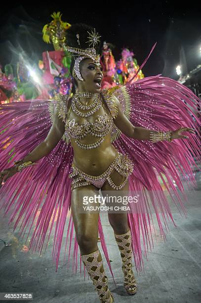Revelers of the Mangueira samba school perform during their carnival parade at Sambadrome in Rio de Janeiro Brazil on February 15 2015 AFP PHOTO /...