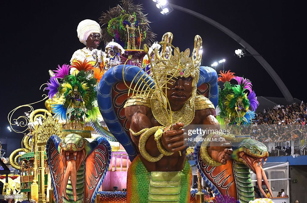 Revelers of the Mocidade Alegre samba school perform during the second night of the carnival parade at the Sambadrome in Sao Paulo, Brazil, on February 6 2016. AFP PHOTO / NELSON ALMEIDA / AFP / NELSON ALMEIDA