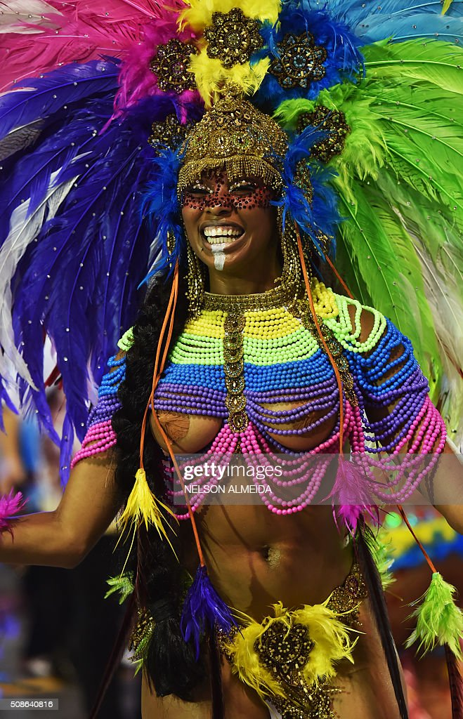 Revelers of the Nene de Perola Negra samba school perform during the first night of the carnival parade at the Sambadrome in Sao Paulo, Brazil, on February 5, 2016. AFP PHOTO/NELSON ALMEIDA / AFP / NELSON ALMEIDA