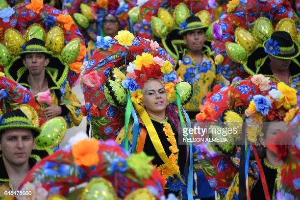 Revelers of the Nene de Vila Matilde samba school perform during the second night of carnival parade at the Sambadrome in Sao Paulo Brazil early on...