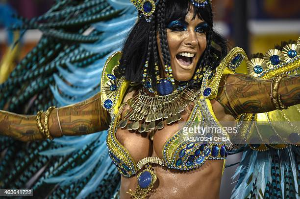 Revelers of the Uniao da Ilha samba school perform during the second day of carnival parade in the Sambodrome in Rio de Janeiro Brazil on February 17...