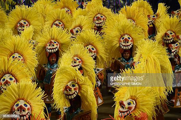 Revelers of the Unidos da Tijuca samba school perform during the second day of carnival parade in the Sambodrome in Rio de Janeiro Brazil on February...