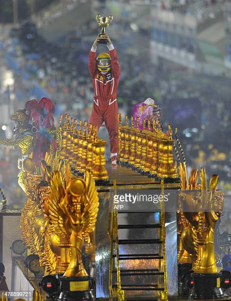 Revelers of the Unidos da Tijuca samba school perform during the second night of carnival parade at the Sambadrome in Rio de Janeiro Brazil on March...