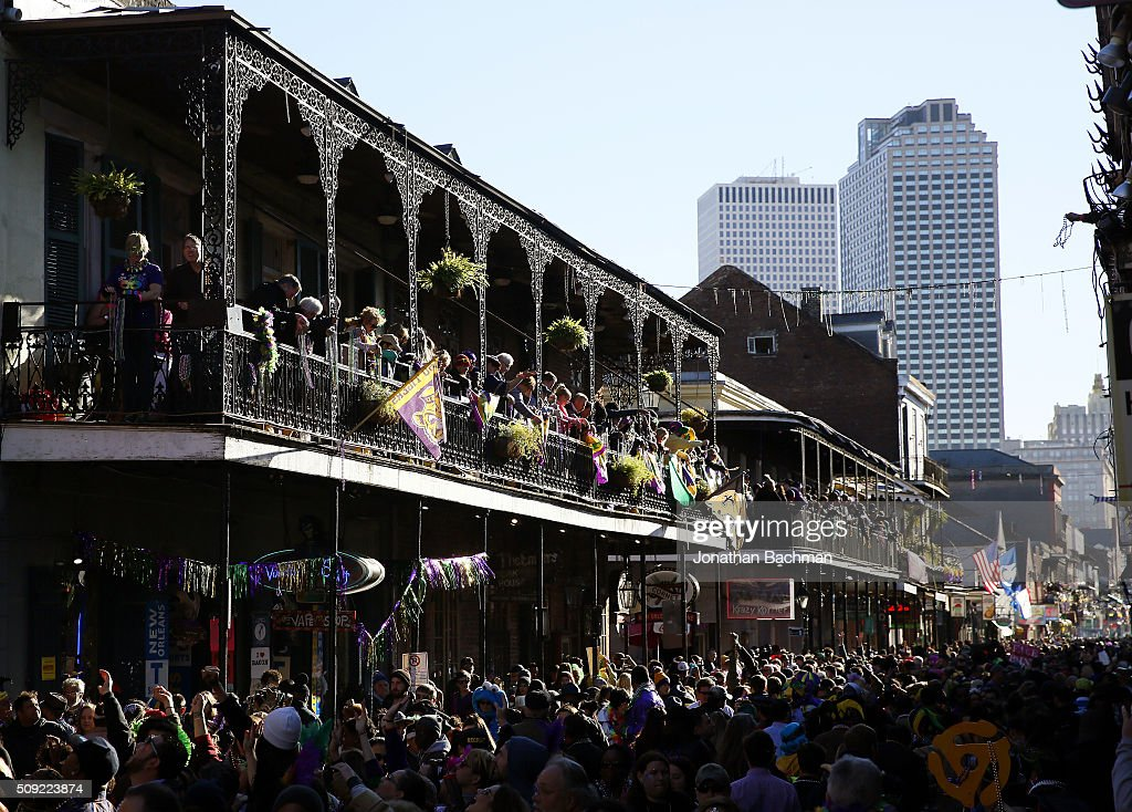 NEW ORLEANS, LOUISIANA - FEBRUARY 9, 2016: Revelers pack Bourbon Street during Mardi Gras day on February 9, 2016 in New Orleans, Louisiana. Fat Tuesday, or Mardi Gras in French, is a celebration traditionally held before the observance of Ash Wednesday and the beginning of the Christian Lenten season.