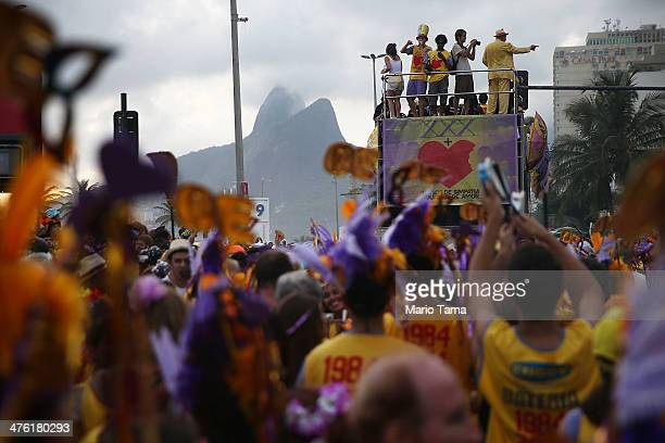 Revelers parade during the 'Simpatia e Quase Amor' street carnival bloco along Ipanema Beach on March 2 2014 in Rio de Janeiro Brazil Carnival is the...