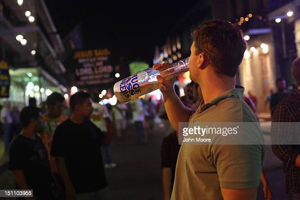 Revelers party on Bourbon Street in the early morning hours on September 1 2012 in the French Quarter of New Orleans Louisiana The Quarter...