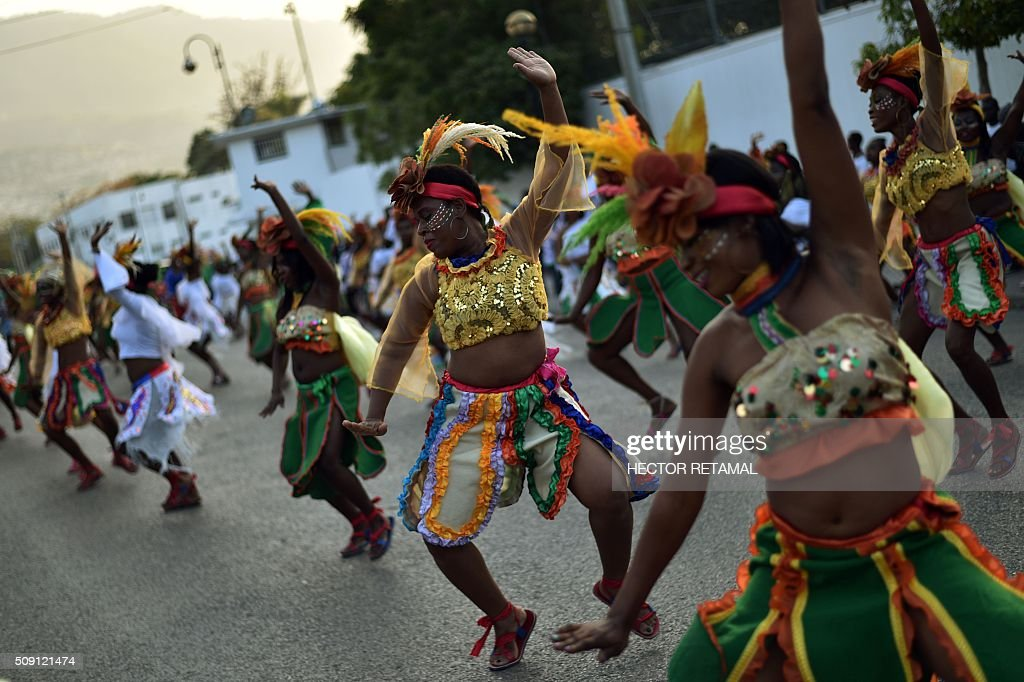 Revelers perform during of 2016 National Carnival Parade on February 9, 2016, in Port-au-Prince, Haiti. The name of the carnival for this year is Ayiti Toutan, in Haitian creole,(Haiti always). Yesterday was suspended the first day of carnival by the political situation affecting Haiti. The name in Haitian creole of the carnival for this year is 'Ayiti Toutan' (Haiti Always). The launch of the carnival the previous day was suspended tdue to the political situation affecting Haiti. / AFP / HECTOR RETAMAL