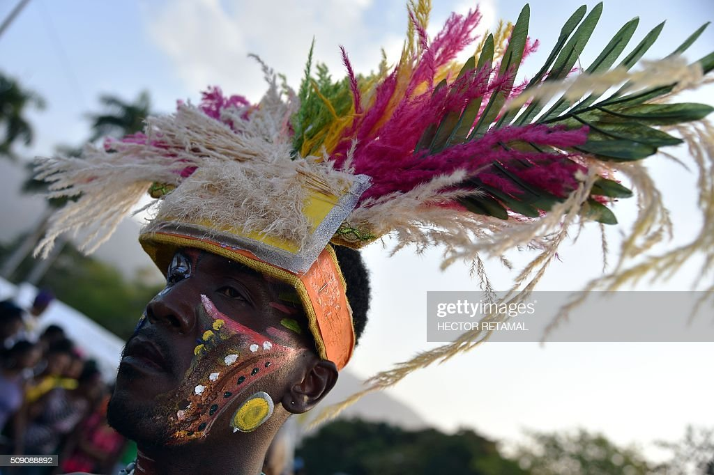 Revelers perform during the 2016 National Carnival Parade on February 9, 2016 in Port-au-Prince, Haiti. The name in Haitian creole of the carnival for this year is 'Ayiti Toutan' (Haiti Always). The launch of the carnival the previous day was suspended tdue to the political situation affecting Haiti. / AFP / HECTOR RETAMAL