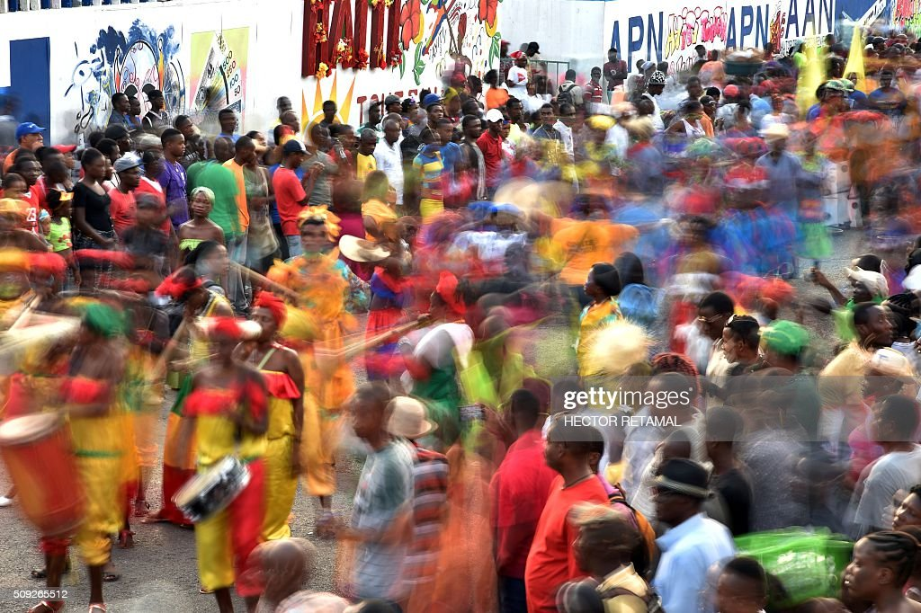 Revelers perform during the 2016 National Carnival Parade on February 10, 2016 in Port-au-Prince, Haiti. The name in Haitian creole of the carnival for this year is 'Ayiti Toutan' (Haiti Always). The launch of the carnival two days ago was postponed due to the political situation affecting Haiti. / AFP / HECTOR RETAMAL