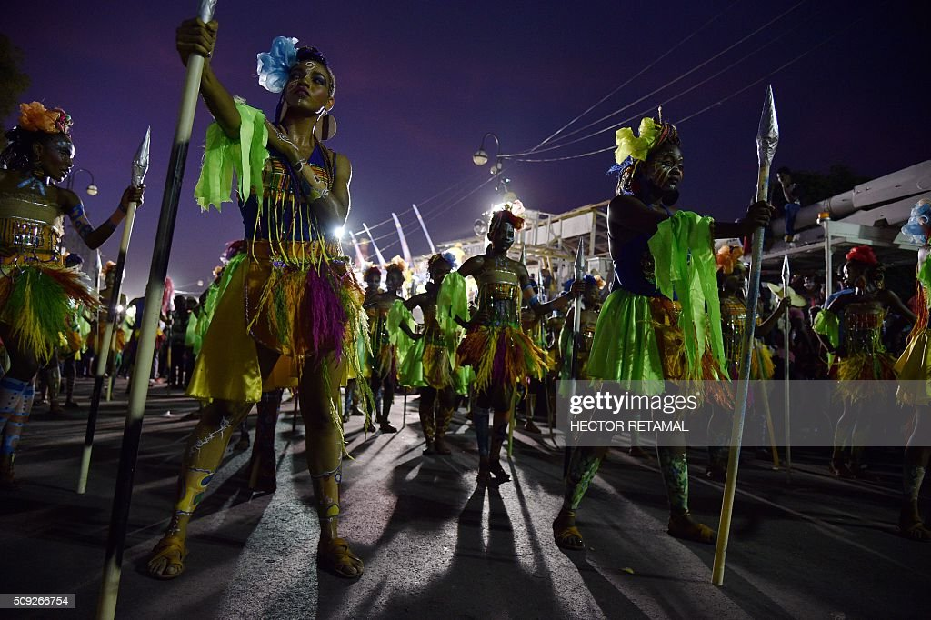 Revelers perform during the 2016 National Carnival Parade on February 10, 2016 in Port-au-Prince, Haiti. The name in Haitian creole of the carnival for this year is 'Ayiti Toutan' (Haiti Always). The launch of the carnival the previous day was suspended due to the political situation affecting Haiti. / AFP / HECTOR RETAMAL