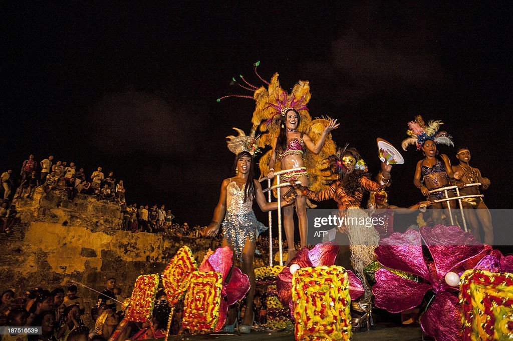 Revelers perform during the Gay Pride Parade in Cartagena, Colombia, on November 9, 2013. AFP PHOTO / Joaquin Sarmiento