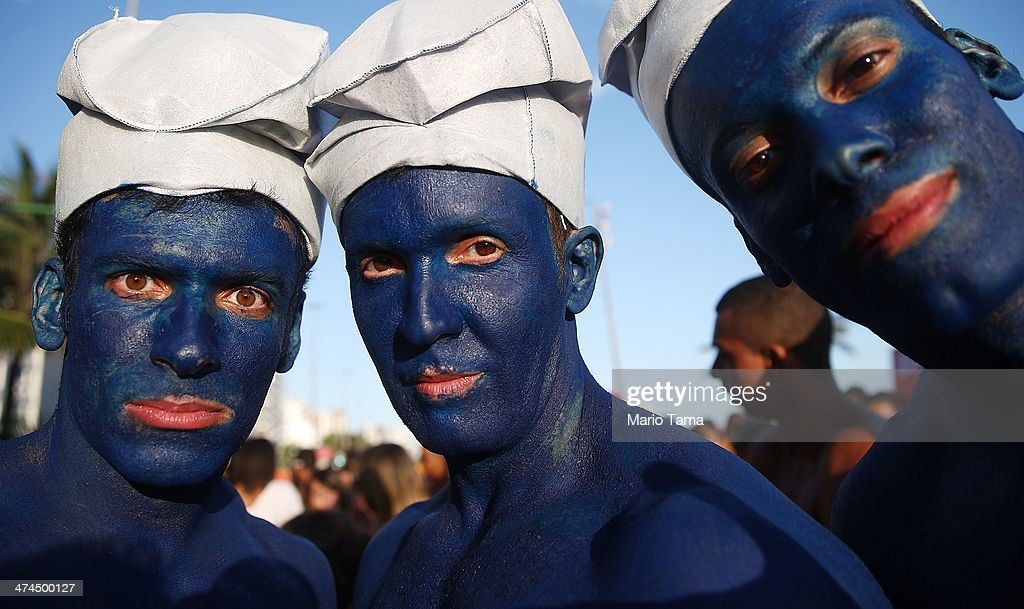 Revelers pose at a 'bloco' street party during pre-Carnival festivities on February 23, 2014 in Rio de Janeiro, Brazil. Carnival officially begins on February 28 but pre-festivities have already begun. Brazil is gearing up to host the 2014 FIFA World Cup.