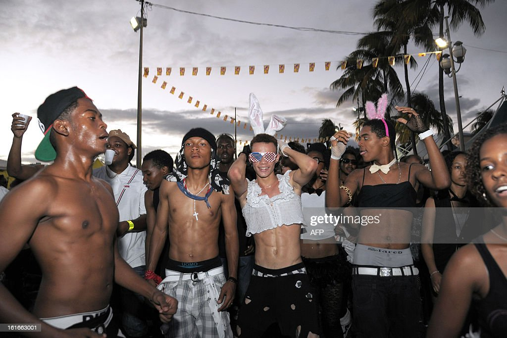 Revelers pose during an Ash Wednesday carnival parade on February 13, 2013 in Fort-de-France on the French Caribbean island of Martinique.