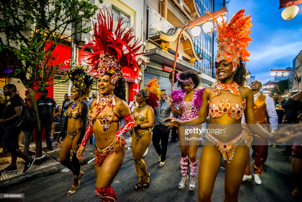 """Revelers pose during street Carnival celebrations. Street carnival in Sao Paulo, many groups, called blocos, has bands and thousands of revelers , costumed or not, following as a parade through the city streets, singing, dancing by the route on February 10, 2017 in Sao Paulo, Brazil. The block of the Spark, formed by electricians and with the theme """"Choque Neles"""", parade through the streets of the neighborhood of freedom in São Paulo."""
