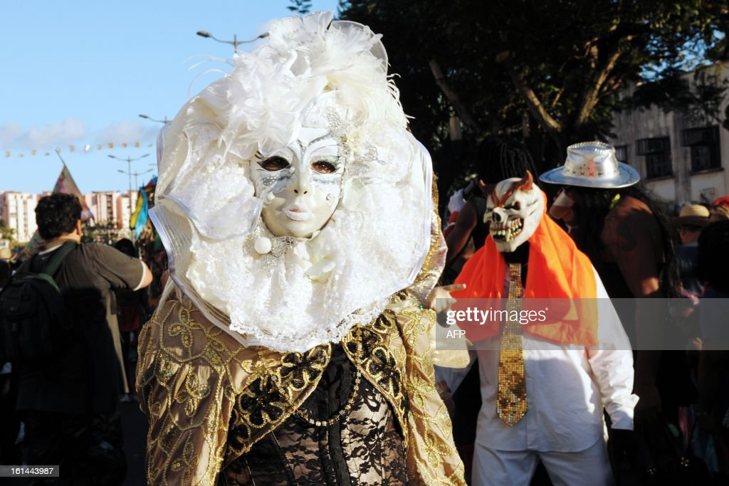Revelers pose during the Carnival parade in the streets of Fort-de-France on the French Caribbean island of Martinique, on February 10, 2013. The Carnaval started on February 9, 2013 and will run until Ash Wednesday on February 13, 2013 when Vaval, a giant papier-mache figure symbolizing the king of the carnival, is burned.