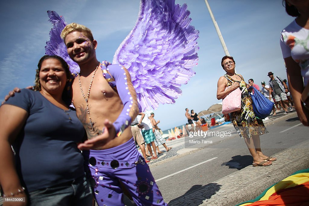 Revelers (L) pose fora photo during Rio de Janeiro's 18th Gay Pride Parade along Copacabana Beach on October 13, 2013 in Rio de Janeiro, Brazil. Brazil is the world's largest Catholic nation with an estimated 60,000 gay couples. In May, Brazil became the third country in Latin America to effectively approve same-sex marriage via a court ruling, but a final law has yet to be passed.