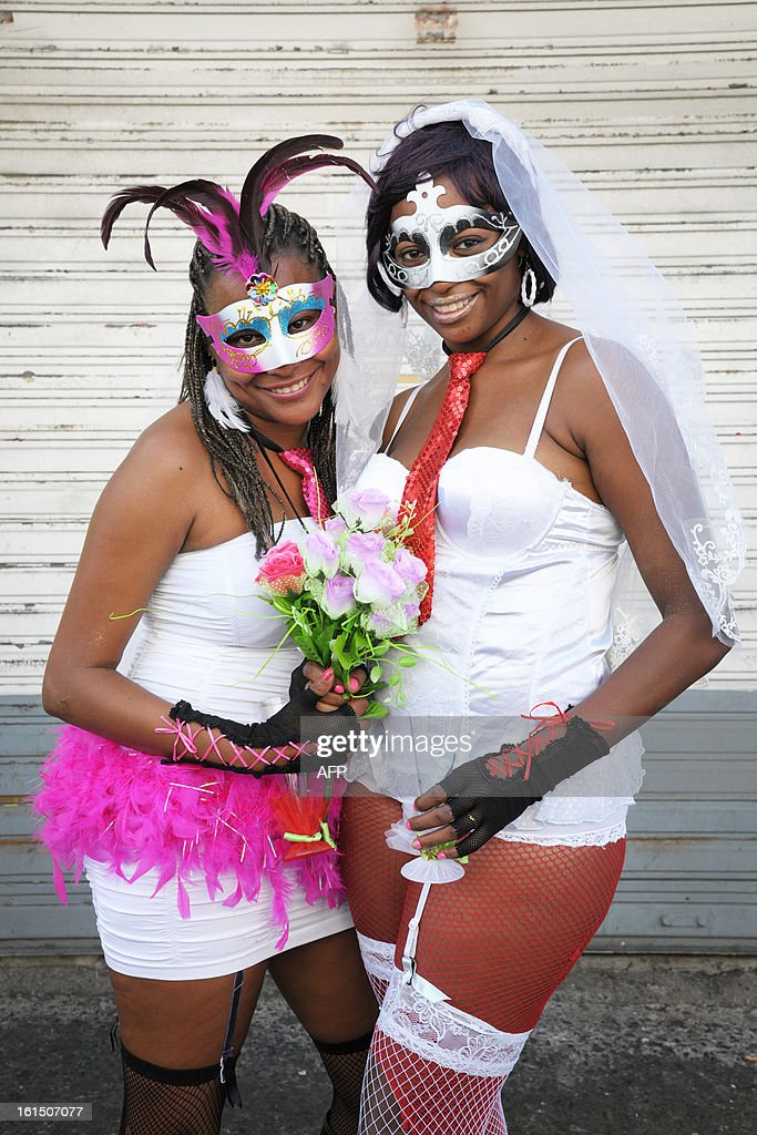 Revelers pose prior to take part in the Carnival parade in the streets of Fort-de-France on the French Caribbean island of Martinique, on February 11, 2013. The Carnaval started on February 9, 2013 and will run until Ash Wednesday on February 13, 2013 when Vaval, a giant papier-mache figure symbolizing the king of the carnival, is burned. AFP PHOTO/ JEAN-MICHEL ANDRE