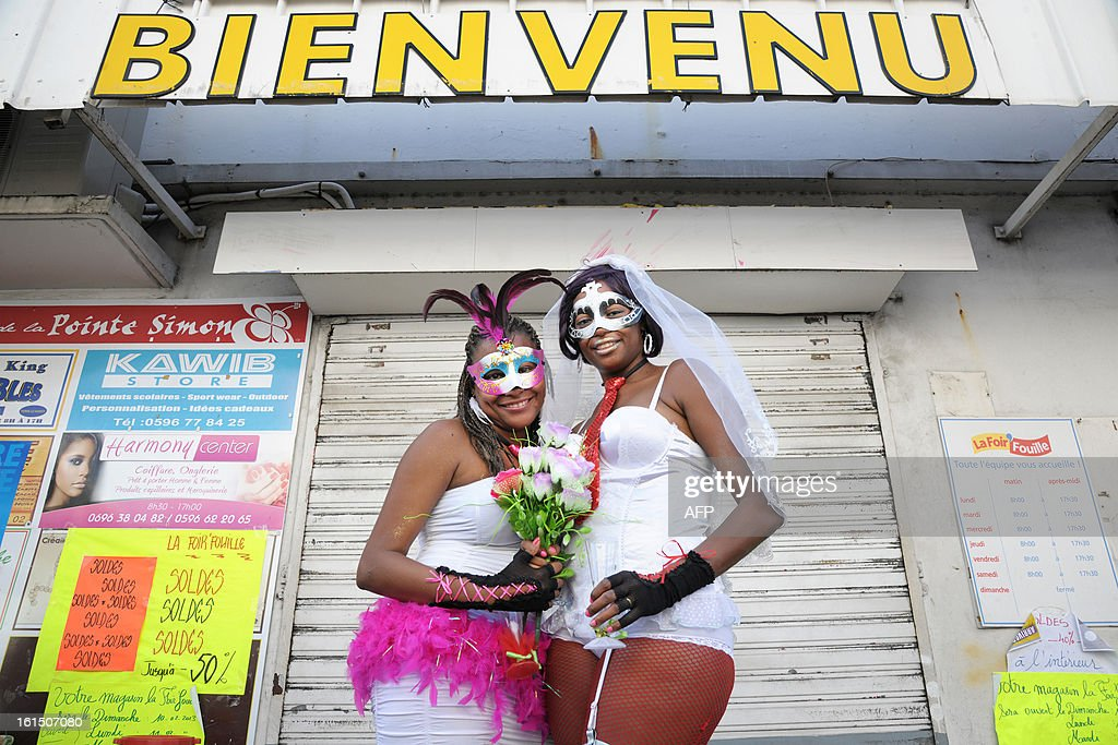 Revelers pose prior to take part in the Carnival parade in the streets of Fort-de-France on the French Caribbean island of Martinique, on February 11, 2013. The Carnaval started on February 9, 2013 and will run until Ash Wednesday on February 13, 2013 when Vaval, a giant papier-mache figure symbolizing the king of the carnival, is burned.