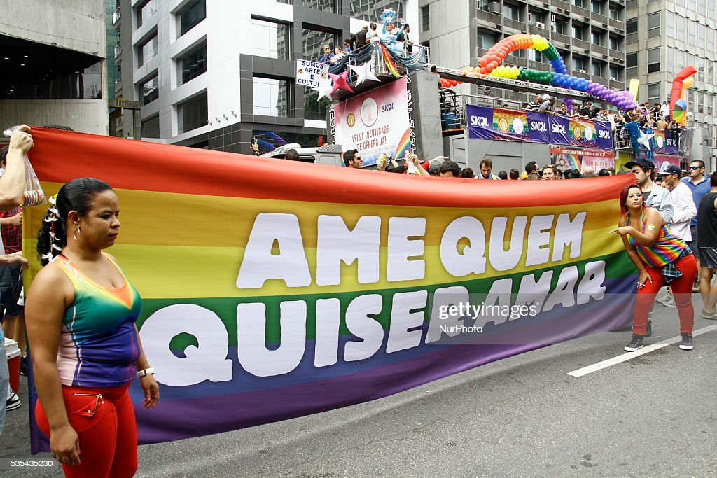Revelers protest against Brazilian interim President Michel Temer during the 20th Gay Pride Parade, in Sao Paulo, Brazil on May 29, 2016.